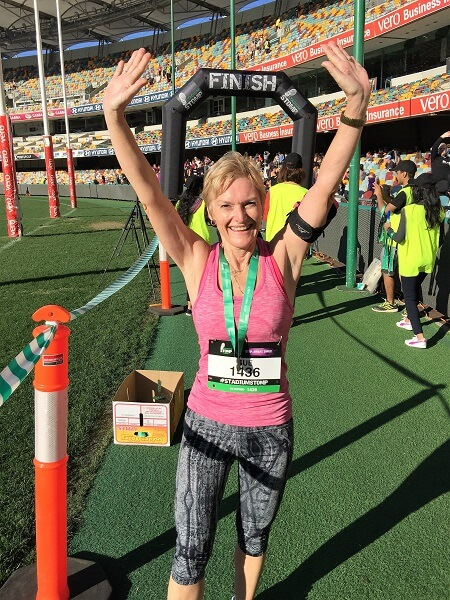 Sue from Sizzling Towards 60 and Beyond completing a marathon