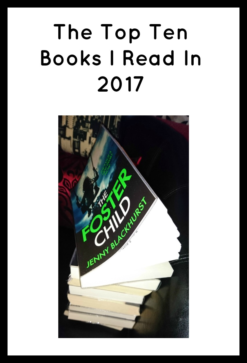 The Top Ten Books I Read In 2017 in black text on a white ackground with a pile of books